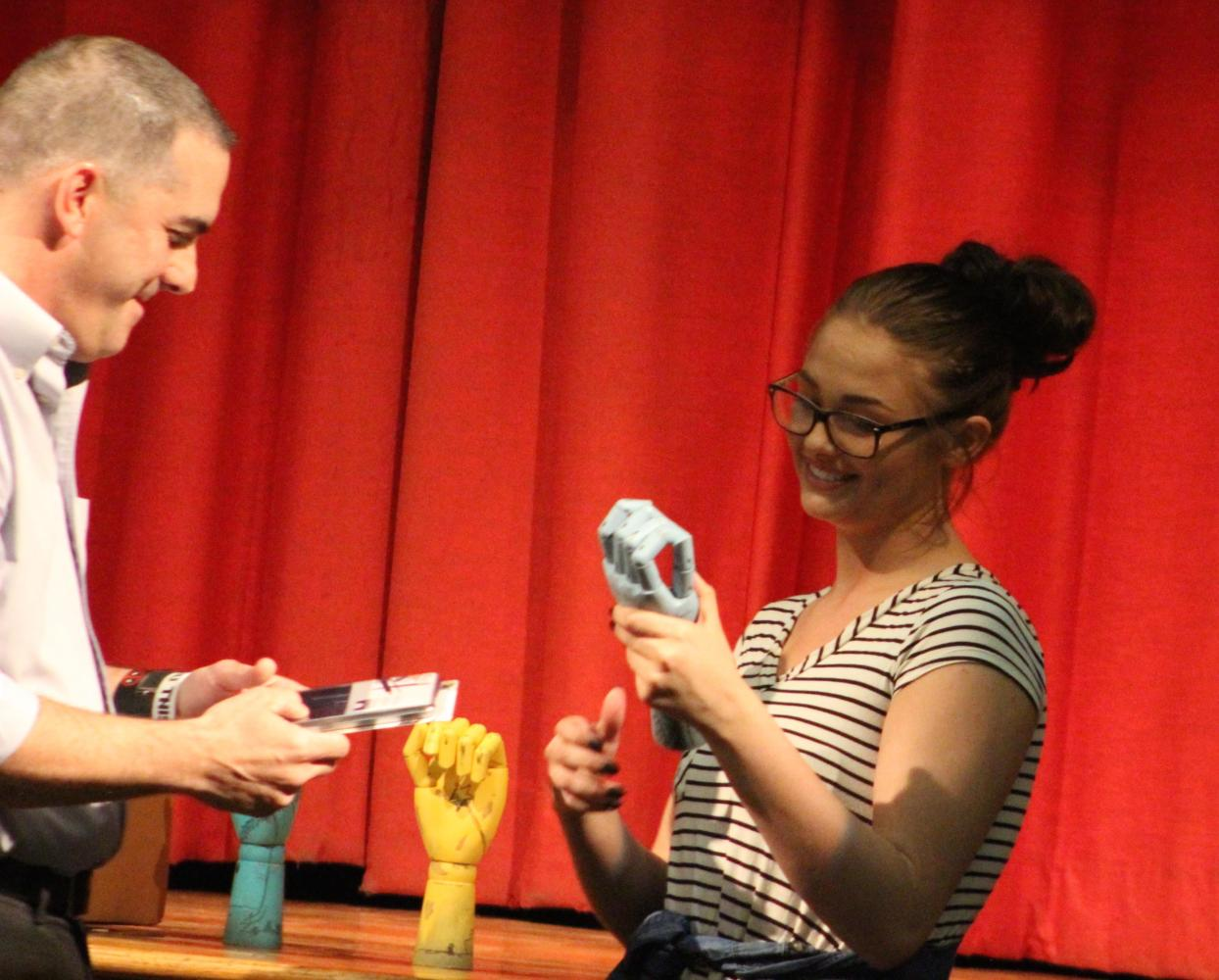 Maddie Zwiebel receives the Art Department Award from Mr. Hurst at the Awards Program.