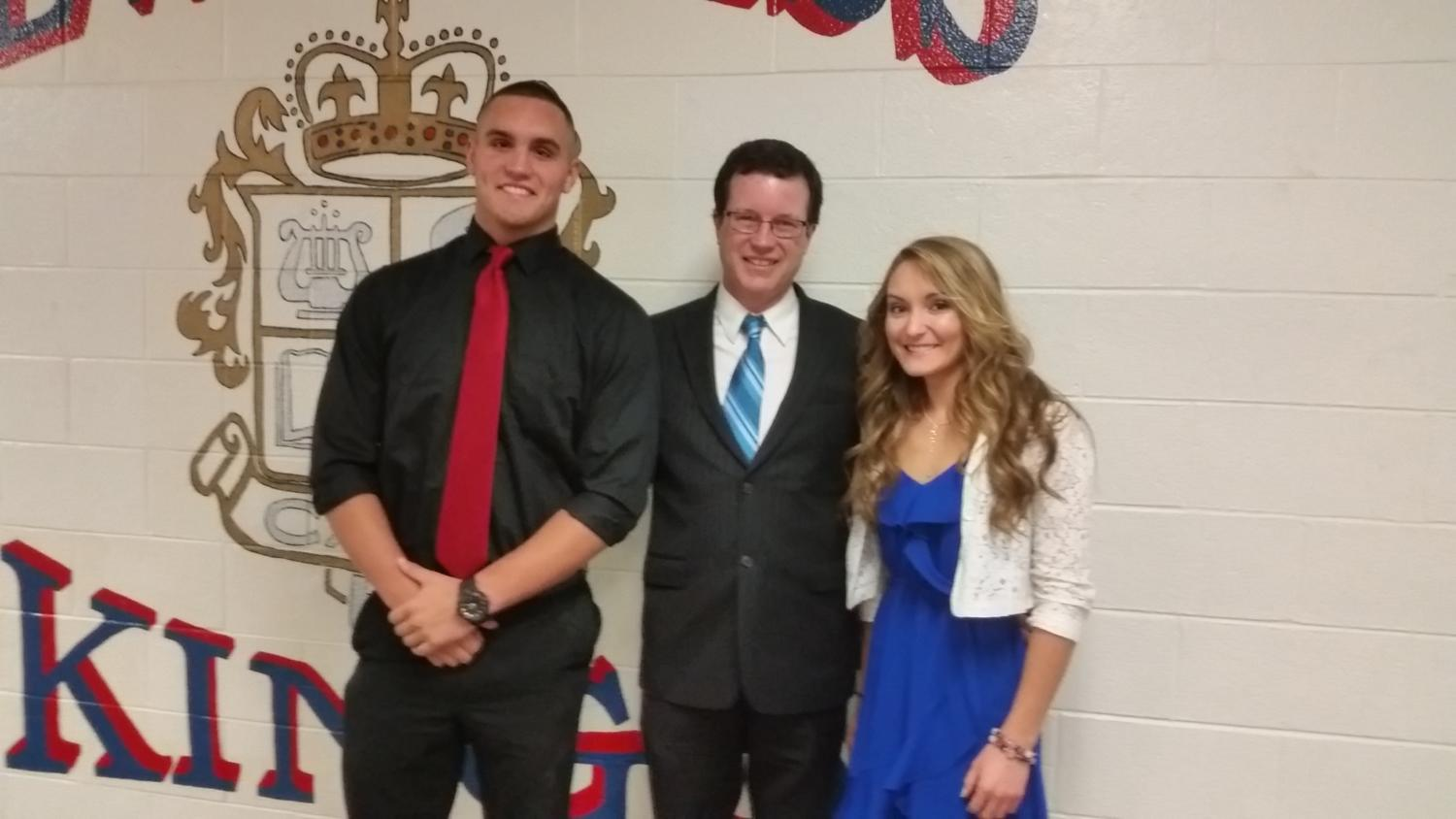 In the photo are two of Mr. Engle's AP English students who selected him this year: Shadd McLochlin  and Savanna Thompson. Both were honored at the Latin Honors Banquet on Sunday., May 21.  Not in the photo- Olivia Johnson