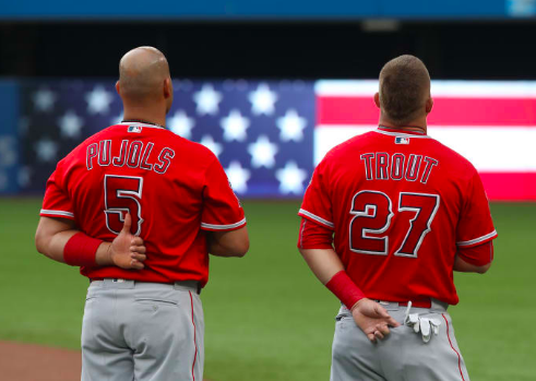 Los Angeles Angels all-star Mike Trout and first baseman Albert Pujols standing for the national anthem.