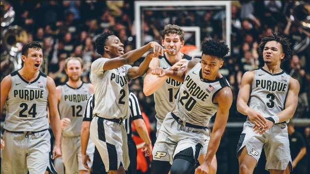 Purdue+players+celebrating+over+a+great+shot