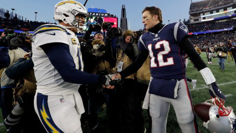 Jan 13, 2019; Foxborough, MA, USA; New England Patriots quarterback Tom Brady (12) and Los Angeles Chargers quarterback Philip Rivers (17) meet after an AFC Divisional playoff football game at Gillette Stadium. Mandatory Credit: David Butler II-USA TODAY Sports